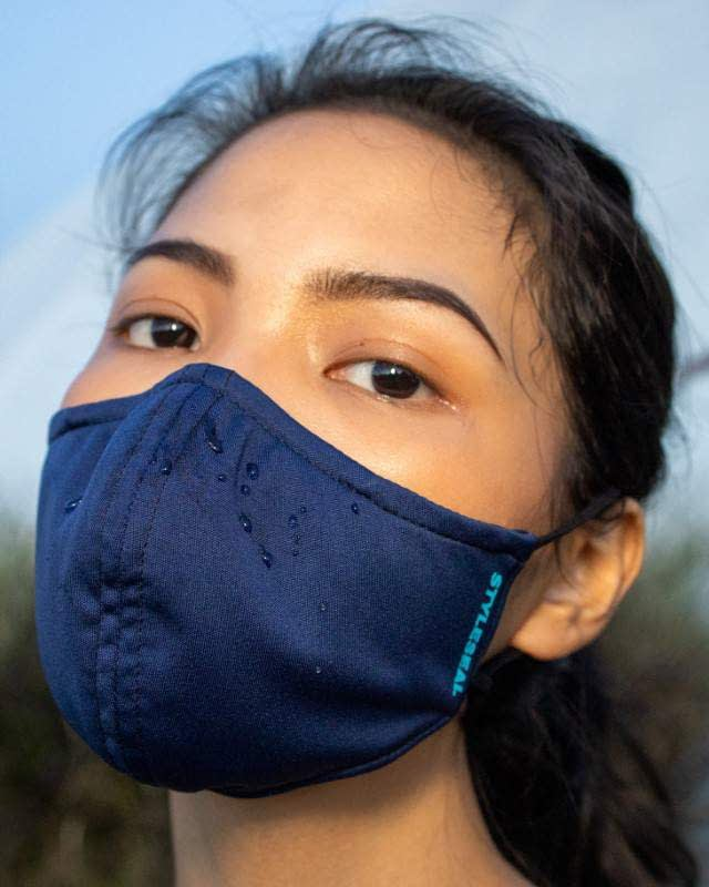 woman wearing styleseal water repellent basic face mask navy blue