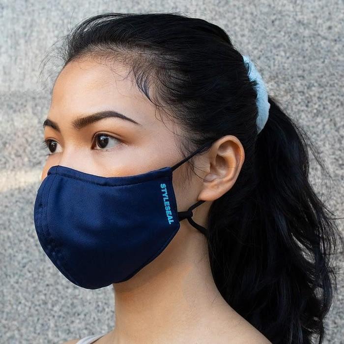 woman wearing styleseal basic face mask navy blue